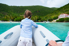 Little girl have a ride on inflatable boat Stock Image