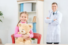 Little girl having appointment with her pediatrician Stock Photos