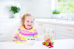Little girl having breakfast Royalty Free Stock Images