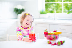 Little girl having breakfast Royalty Free Stock Photo