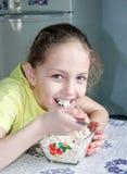 Little girl having breakfast Stock Image