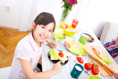 Little girl having breakfast at home Royalty Free Stock Photos