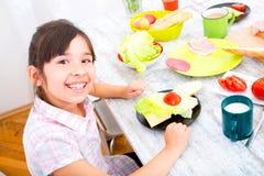 Little girl having breakfast at home Stock Image