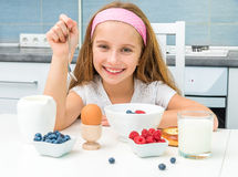 Little girl having breakfast Royalty Free Stock Photography