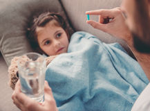 Little girl having a cold Stock Photography