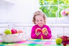 Little girl having fruit for breakfast Stock Photo