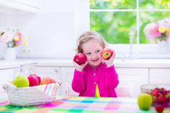 Little girl having fruit for breakfast Stock Photo