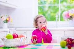 Little girl having fruit for breakfast Royalty Free Stock Photos