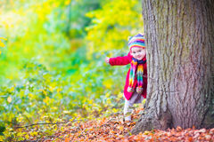 Little girl having fun in an autumn park Royalty Free Stock Photo