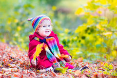 Little girl having fun in an autumn park Royalty Free Stock Image