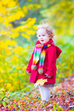 Little girl having fun in an autumn park Stock Photography