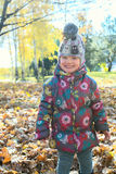 Little girl having fun. Autumn. Little girl having fun in the park at sunny autumn day Stock Images