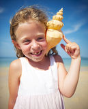 Little girl having fun on a beach Royalty Free Stock Image