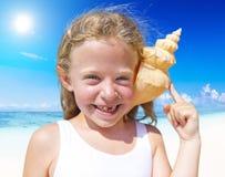 Little girl having fun on a beach Royalty Free Stock Photos