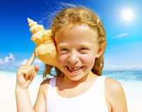 Little girl having fun on a beach joy Concept Stock Photo