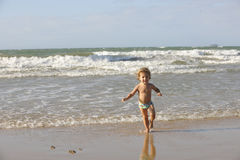 Little girl having fun on the beach. Stock Photography
