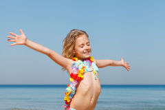 Little girl having fun on a beach Stock Image