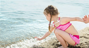Little girl having fun on beach vacation Royalty Free Stock Images