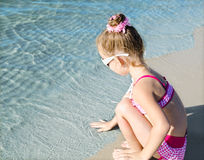 Little girl having fun on beach vacation Stock Image