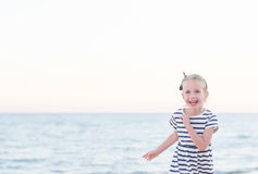 Little girl having fun on beach vacation. Stock Photography