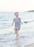 Little girl having fun on beach vacation. Stock Image