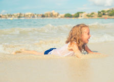 Little girl having fun on beach. Stock Photography