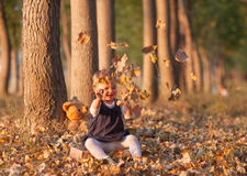 Little girl having fun on beautiful autumn day Royalty Free Stock Photography