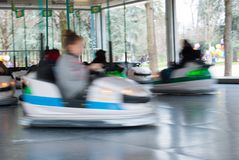 Little girl having fun on bumper cars. Afternoon at the playground games with the family Royalty Free Stock Images