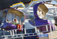 Little girl having fun in carousell Royalty Free Stock Photos