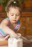 Little girl having fun cooking Stock Photo