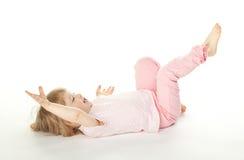 Little girl having fun on the floor Stock Photo