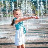 Little girl having fun in fountain Royalty Free Stock Image