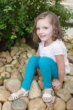 little girl having fun at the garden park Stock Photography