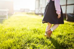 Little girl having fun in the garden, runing at the green grass. Royalty Free Stock Images