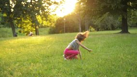 Little Girl Having Fun On The Green Grass While Making a Acrobatic Wheel. Young Sporty Kid Has a Really Good Mood. HD, Outdoors, Park stock video
