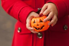 Little girl having fun at Halloween trick or treat. Kids trick or treating. Toddler kid with jack-o-lantern. Children with candy b. Little girl having fun at Royalty Free Stock Images