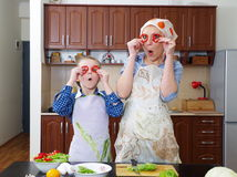 Little girl is having fun with  her mother Stock Photos