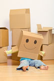 Little girl having fun in her new home unpacking Royalty Free Stock Image