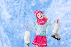 Little girl having fun at ice skating in winter Royalty Free Stock Photos