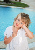 A little girl having fun near the pool Royalty Free Stock Image
