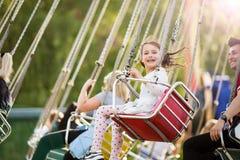 Free Little Girl Having Fun On Chain Carousel. Stock Photos - 170932103