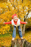 Little girl having fun outdoors Stock Images
