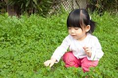 Little girl having fun in park Stock Photo