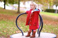 Little girl having fun in the park Royalty Free Stock Photos