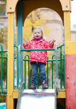 Little girl having fun on the playground Stock Photography
