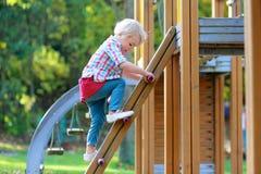 Little girl having fun at playground Stock Photo