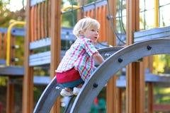 Little girl having fun at playground Stock Image