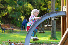 Little girl having fun at playground Stock Photography