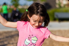 Little girl having fun at the playground Royalty Free Stock Photo