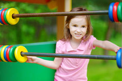 Little girl having fun at a playground Stock Photography